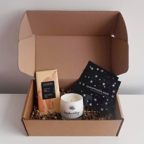 Gift box with Coco chocolate, space masks and glass candle.